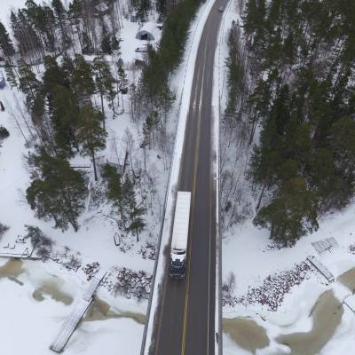 Aerial photograph by drone of a Renault Truck on a snowy road in Norway