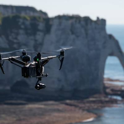 Flying UAV Inspire 2 for tourism, institutional and corporate filming, in front of the cliffs of Etretat, Hauts-de-France