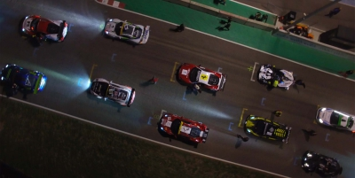 Car race filmed by night with a drone
